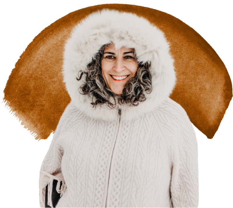 Alexsys wearing a white fuzzy winter coat and smiling
